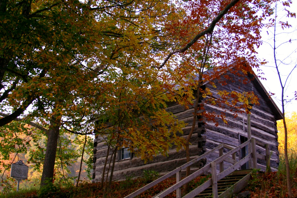 An old 1800 country church with surrounding fall foliage in the west